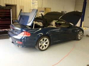 Repair of a convertible top on a BMW 645i.