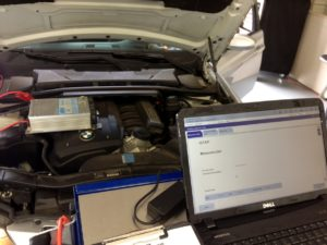 BMW 3-series (E90) getting software update after component replacement.