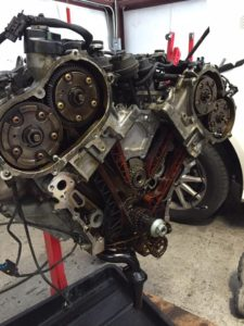 Mercedes M272 front cover removed for balance shaft replacement.