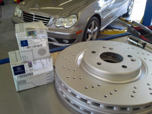 "Genuine Mercedes-Benz brake pads and high quality ""sport"" package rotors."